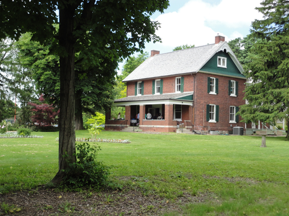 June 2014 - Here's what the farmhouse looks like today. The family deeded the home, original barn, and farm buildings along with a large plot of land. Green acres!