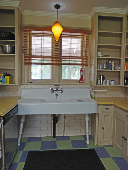Kitchen confidential a-la- turn of the last century - except for the crazy light fixture. Who's up for some dishes tonight?