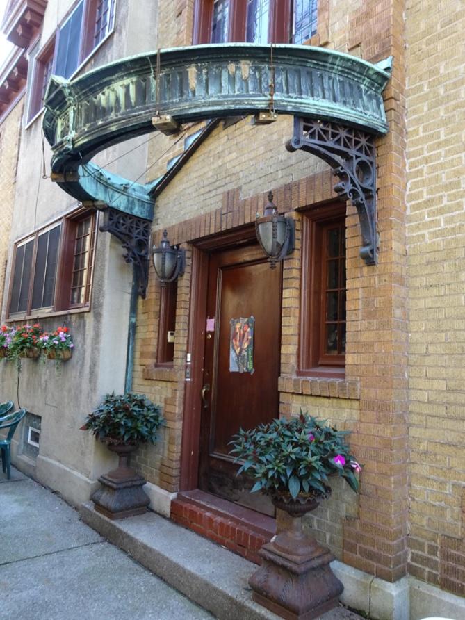 Jungels Side Door bronze crown awning Buffalo