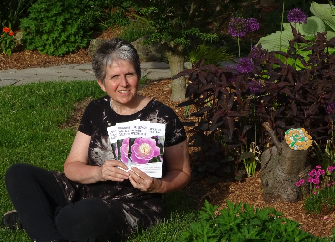 Sheila Gregory with ticket books in Garden.jpg